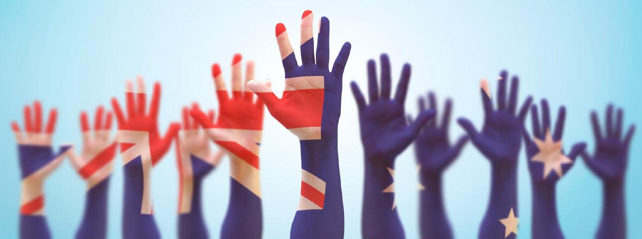 Hand raised with Australian flag